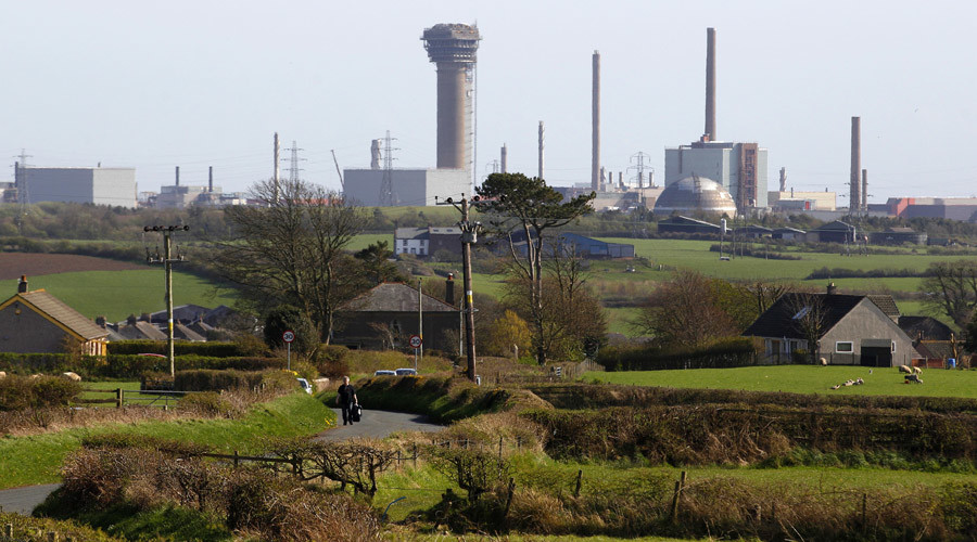 A man walks along a road near the Sellafield nuclear reprocessing site near Seascale in Cumbria, England © David Moir