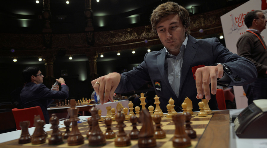 Russian grandmaster Sergey Karjakin adjusts his pieces before a game against Norwegian world chess champion Magnus Carlsen at the IX Chess Masters Final in Bilbao © Vincent West