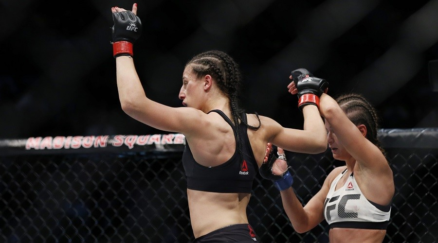 Joanna Jedrzejczyk (red gloves) reacts after defeating Karolina Kowalkiewicz (blue gloves) in their strawweight title bout during UFC 205 at Madison Square Garden. Nov 12, 2016; New York, NY, USA;  Adam Hunger-USA TODAY Sports