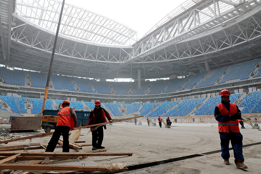 Labourers work at a new stadium under construction on Krestovsky Island, known as Zenit Arena, that will host 2017 FIFA Confederations Cup and 2018 FIFA World Cup matches, in St. Petersburg, Russia, October 3, 2016. ©Pawel Kopczynski