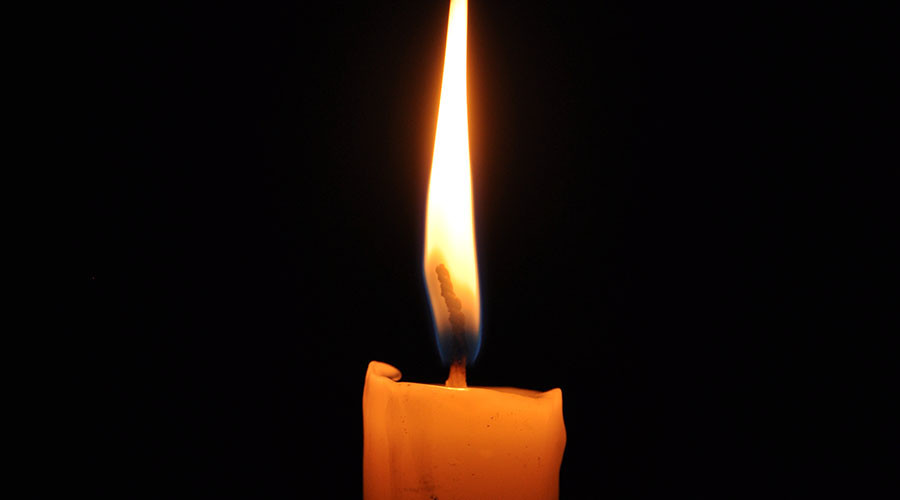 Candle blaze kills woman, prompts anger over Spanish energy prices