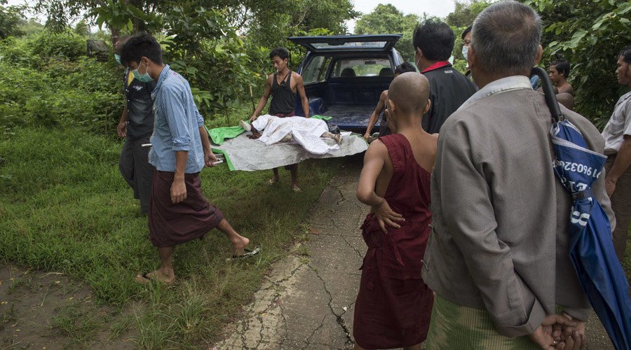 In this file photo taken on October 22, 2016, hospital workers carry the body of three-year-old Nay La Linn, a victim of an exorcism ritual, for burial at a public cemetery in Twante town, south of Yangon. © Romeo Gacad