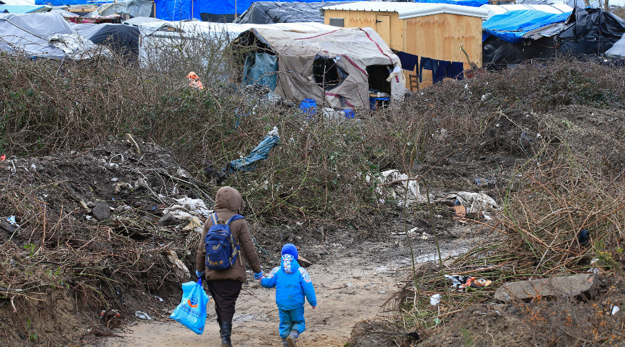 Refugee children from Calais camp forced to work on farms in France – report