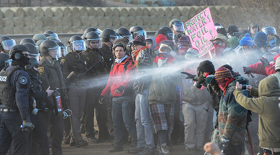 FILE PHOTO: Police mace protesters during a demonstration against the Dakota Access pipeline near the Standing Rock Indian Reservation in Mandan, North Dakota, U.S. © Stephanie Keith