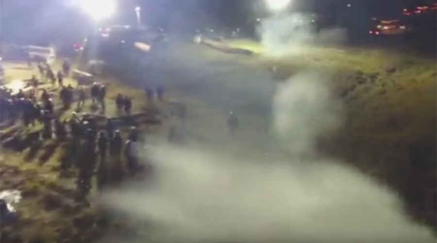 Drone narrowly escapes water cannon jet during DAPL protest (VIDEO)
