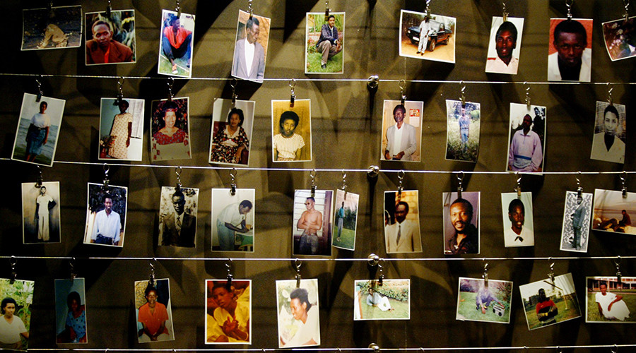 Pictures of killed people donated by survivors are installed on a wall inside the Gisozi memorial in Kigali April 5, 2004 which depicts the country's 1994 genocide © Radu Sigheti