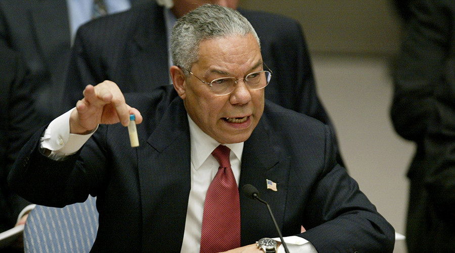 FILE PHOTO: U.S. Secretary of State Colin Powell holds up a vial that he described as one that could contain anthrax, during his presentation on Iraq to the U.N. Security Council, in New York February 5, 2003 © Ray Stubblebine