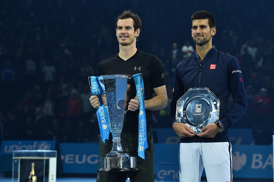 Britain's Andy Murray (L) poses with the ATP World Tour Finals trophy (L) with runner up Serbia's Novak Djokovic (R) after Murray won the men's singles final on the eighth and final day of the ATP World Tour Finals tennis tournament in London on November 20, 2016 © Glyn Kirk