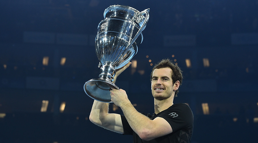 Britain's Andy Murray poses holding the ATP World Number One trophy after winning the men's singles final against Serbia's Novak Djokovic on the eighth and final day of the ATP World Tour Finals tennis tournament in London on November 20, 2016 © Glyn Kirk