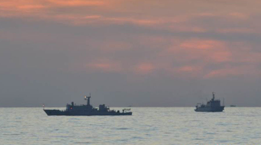 FILE PHOTO. This undated handout photo taken by Philippine navy and released April 11, 2012 by the Department of Foreign Affairs shows Chinese surveillance ships off scarborough Shoal. © DFA / PN