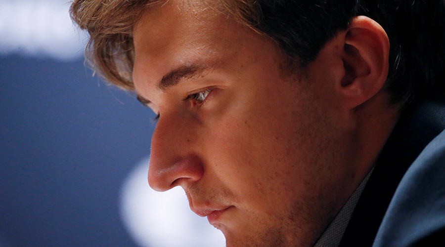 Sergey Karjakin, of Russia, stares at the chess board during his match with Magnus Carlsen, of Norway, in the fifth round of the 2016 World Chess Championship in New York U.S., November 17, 2016 © Shannon Stapleton