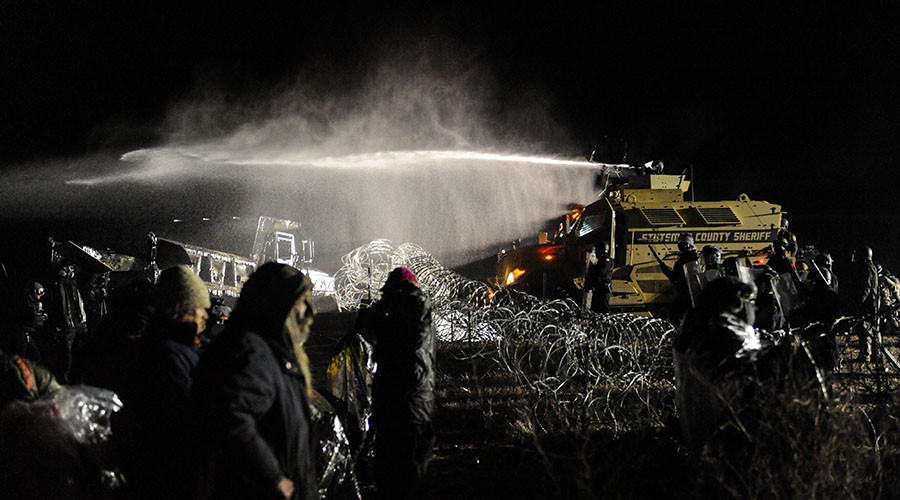 Police use a water cannon on protesters during a protest against plans to pass the Dakota Access pipeline near the Standing Rock Indian Reservation, near Cannon Ball, North Dakota, U.S. November 20, 2016. ©Stephanie Keith