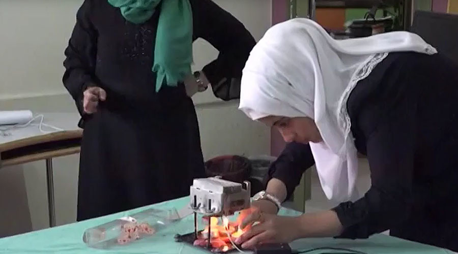 Bright idea: Gaza teen generates electricity from candles to overcome power cuts (VIDEO)