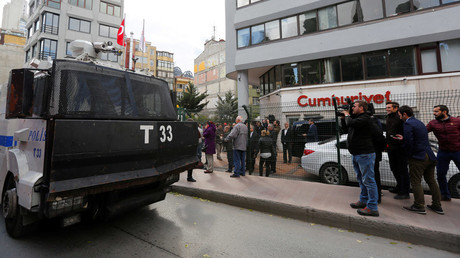 An armored police vehicle drives past by the headquarters of Cumhuriyet newspaper, an opposition secularist daily, in Istanbul, Turkey, October 31, 2016. © Murad Sezer