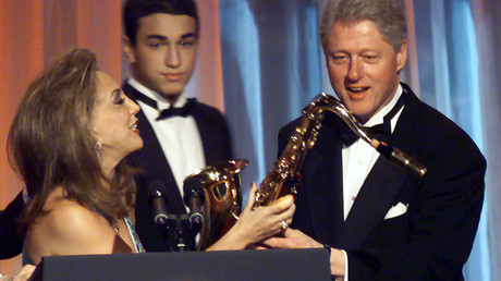 Denise Rich (L) presents former U.S. President Bill Clinton with a saxophone at the G&P Foundation gala in New York City, in this file photo from November 30, 2000 ©
