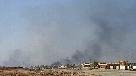 FILE PHOTO: Smoke rises over Karama district in Mosul where Iraqi troops are fighting Islamic State. © Stephen Kalin