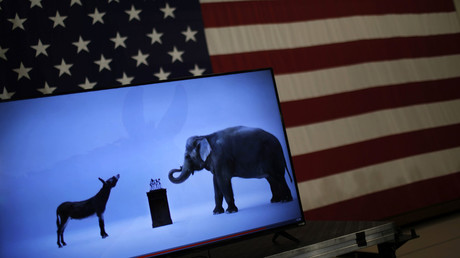 The mascots of the Democratic and Republican parties, a donkey for the Democrats and an elephant for the GOP, are seen on a video screen at Democratic U.S. presidential candidate Hillary Clinton's campaign rally in Cleveland, Ohio. © Carlos Barria