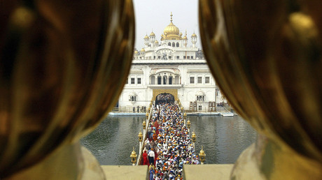 Devotees throng the holy Sikh shrine of Golden temple in the northern Indian city of Amritsar. © Munish Sharma