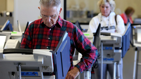 Voters cast ballots as early absentee voting began ahead of the U.S. presidential election in Medina, Cleveland, Ohio, U.S. October 12, 2016. © Aaron Josefczyk