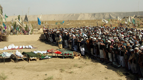Afghans perform prayers at the funeral for the victims killed by an air strike called in to protect Afghan and U.S. forces during a raid on suspected Taliban militants, in Kunduz, Afghanistan November 4, 2016. © Nasir Wakif