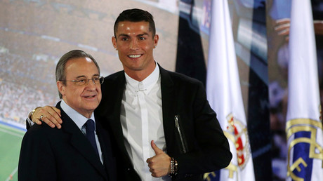 Cristiano Ronaldo (R) poses with Real Madrid's president Florentino Perez after a ceremony for his contract renewal © Susana Vera