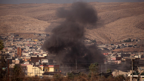 Smoke rises during clashes between Peshmerga forces and Islamic State militants in the town of Bashiqa, east of Mosul, during an operation to attack Islamic State militants in Mosul, Iraq, November 7, 2016. © Azad Lashkari