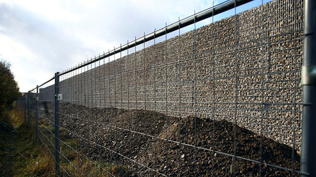 Gerneal view of a 13ft-high (4 m) stone wall which is being built to separate a residents housing development from a migrant accommodation facility in Neuperlach outside Munich, November 8, 2016. ©Michael Dalder
