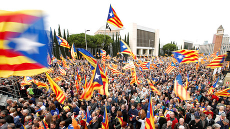 People hold Catalan separatist flags, known as
