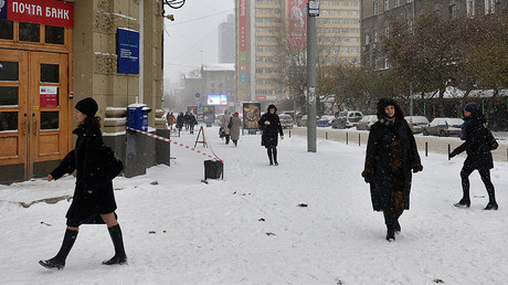Pedestrians experience a snowfall on Lenin Street, Novosibirsk, Russia. © Alexandr Kryazhev