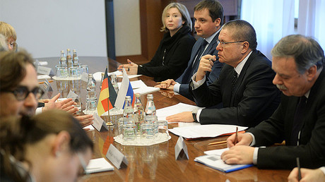 Russian Economic Development Minister Aleksei Ulyukaev (second right) © Grigoriy Sisoev