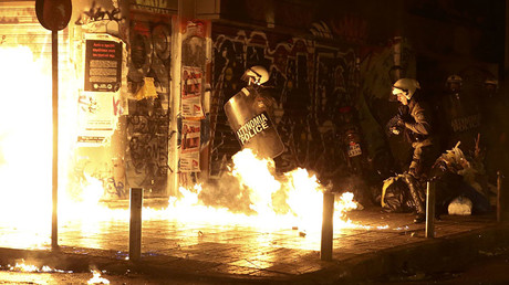 A petrol bomb explodes next to riot police during a demonstration against the visit of U.S President Barack Obama, in Athens, Greece, November 15, 2016. © Alkis Konstantinidis