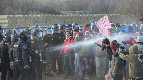 Police mace protesters during a demonstration against the Dakota Access pipeline near the Standing Rock Indian Reservation in Mandan, North Dakota, U.S. November 15, 2016. © Stephanie Keith