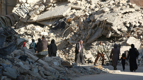 FILE PHOTO People walk past rubble of damaged buildings in a rebel-held besieged area in Aleppo, Syria © Abdalrhman Ismail