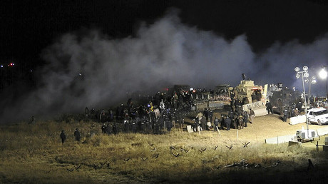 Law enforcement officers surround demonstrators protesting against plans to pass the Dakota Access pipeline during a standoff at the Backwater Bridge in Morton County, North Dakota, U.S., November 20, 2016. © Morton County Sheriff's Department / Handout via Reuters