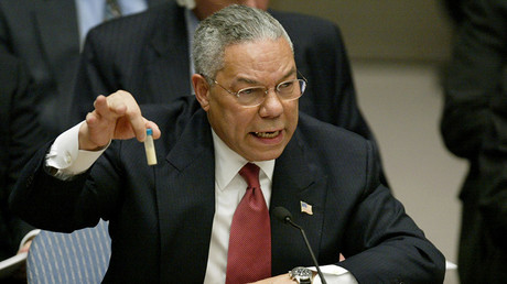 FILE PHOTO: U.S. Secretary of State Colin Powell holds up a vial that he described