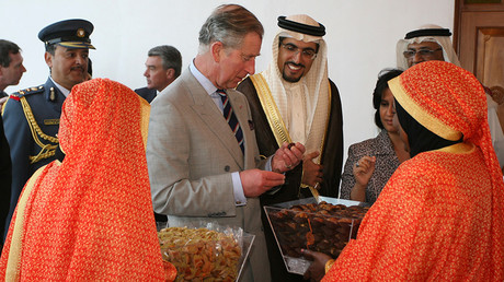 FILE PHOTO: Britain's Prince Charles take a piece of Bahraini dates served by women wearing traditional clothes as Abdul Hakeem Al Khayat, General Manager of Kuwait Finance House watches at Abdulla Zayed House in Manama February 26, 2007 © Hamad Mohammed