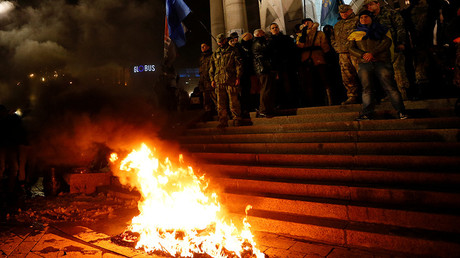 Activists of nationalist groups and their supporters burn tyres in Independence Square as they gather to mark the anniversary of the 2014 Ukrainian pro-European Union (EU) mass protests on the Day of Dignity and Freedom in central Kiev, Ukraine, November 21, 2016 © Valentyn Ogirenko