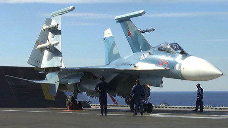 Su-33 fighter on the deck of Admiral Kuznetsov aircraft carrier. © Ministry of defence of the Russian Federation