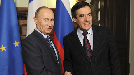 FILE PHOTO. Russia's Prime Minister Vladimir Putin (L) and his French counterpart Francois Fillon shake hands as they meet in Moscow, November 18, 2011. © Natalia Kolesnikova