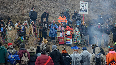 Protesters participate in a prayer circle on Turtle Island on Thanksgiving day during a protest against plans to pass the Dakota Access pipeline near the Standing Rock Indian Reservation, near Cannon Ball, North Dakota, U.S. November 24, 2016. © Stephanie Keith