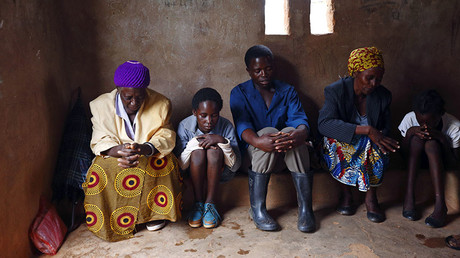 HIV-positive members of a self-help group pray at the start of a meeting in the village of Michelo, south of the Chikuni Mission in the south of Zambia. ©Darrin Zammit