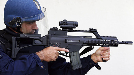 A French gendarme of PSIG (the surveillance and intervention patrols of the gendarmerie) holds an HK G36 assault rifle © Regis Duvignau
