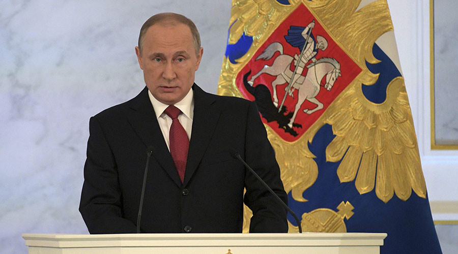 Putin praises people's unity, but says there's no way back to ideological monopoly