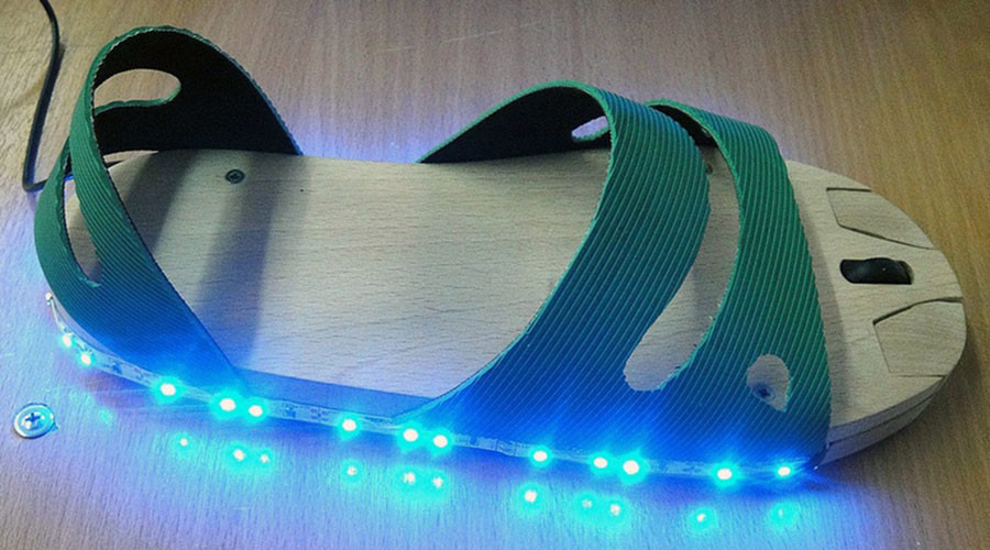 Russian teen invents LED 'mouse-sandal' for people who have no hands