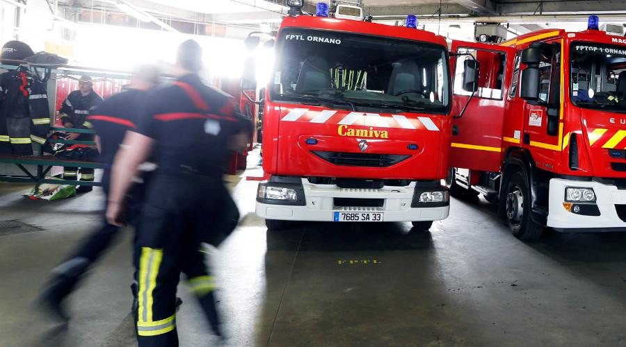 1 dead, 14 injured in blaze at Paris migrant center