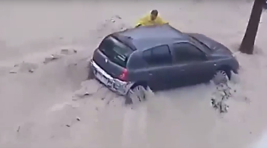 Man swept to his death in violent flood as Spain battles fierce storms (VIDEO)
