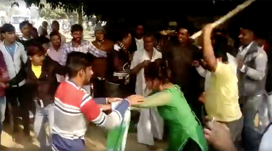 Woman beaten with stick in India for resisting sexual assault (VIDEO)