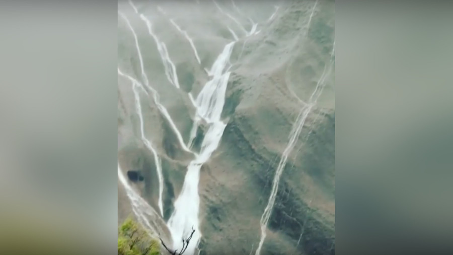Record-breaking desert rains send waterfalls down Australia's Ayers Rock (VIDEO)