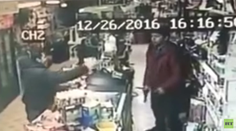 Teenage shop clerk fearlessly snatches gun from armed robber (VIDEO)