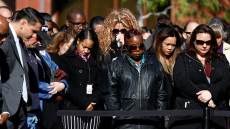 Attendees bow their heads during a memorial event at the Inland Regional Center on the one year anniversary of the San Bernardino attack in San Bernardino, California, U.S. December 2, 2016. © Patrick T. Fallon